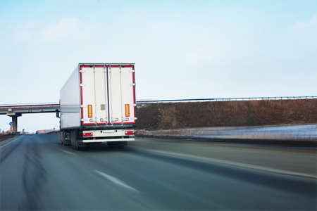 semi trailer: big white truck goes on road Stock Photo