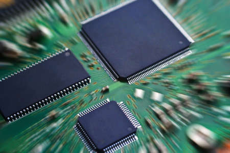 electronic scheme: Microcircuit microchips on green electronic payment Stock Photo
