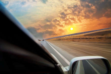 car moves on road towards to sunset Stock Photo - 13338013