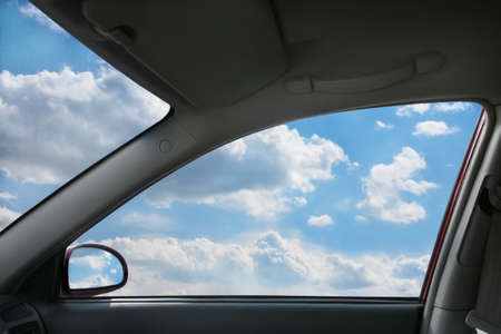 car glass: Heavenly landscape behind  car window Stock Photo