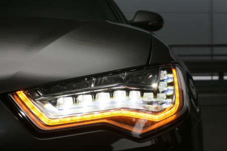 prestigious: headlight of  modern prestigious car close up