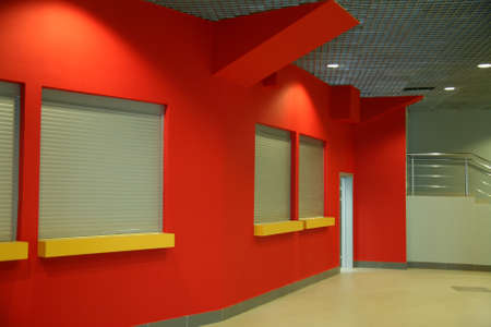 Interior of office building with red wall windows and door
