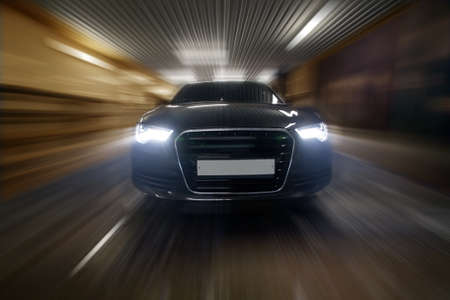 headlights: prestigious car goes in city tunnel