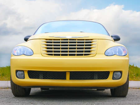 yellow car: big yellow car against sky