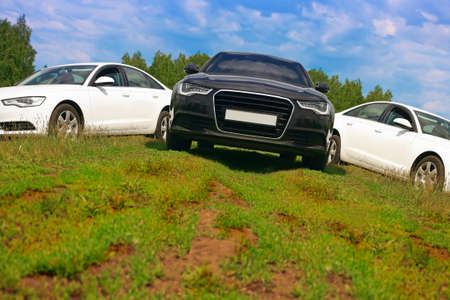 Three cars symmetrically on nature Stock Photo - 14173436
