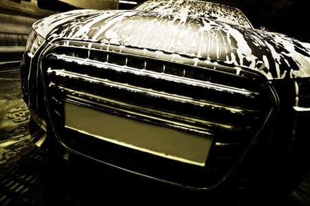 car clean: dark prestigious car on car wash Stock Photo