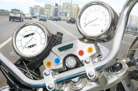 Forward part of motorcycle with speedometer and tachometre photo