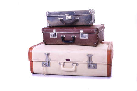 Three old suitcases on white background photo