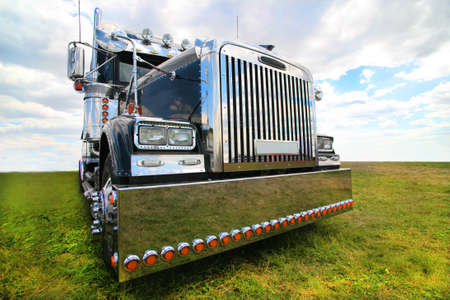 big black brilliant American truck in field photo