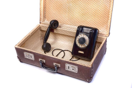 rotational: Old rotational phone in old suitcase Stock Photo
