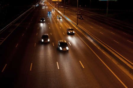 Cars going night on wide motorway Stock Photo - 14600668