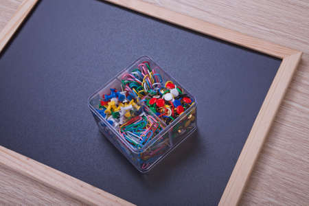Colour stationery on black board in transparent box photo