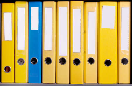 abreast:  Business folders abreast in case at office Stock Photo