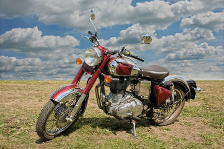 old motorcycle: classical red chromeplated motorcycle on nature