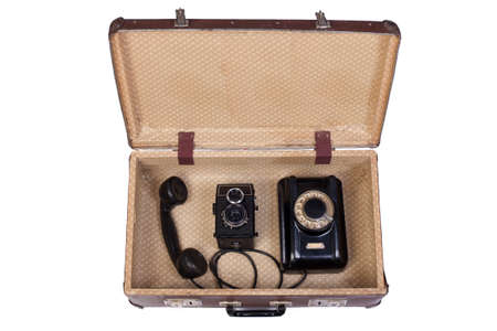 rotational: Old rotational phone and  film camera in an old suitcase Stock Photo