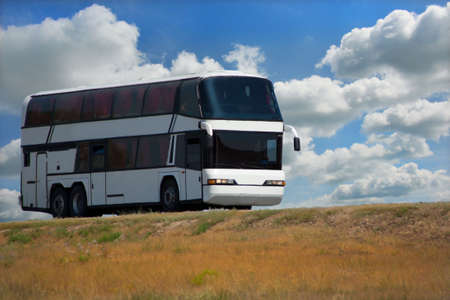 country highway: white tourist bus on country highway Stock Photo