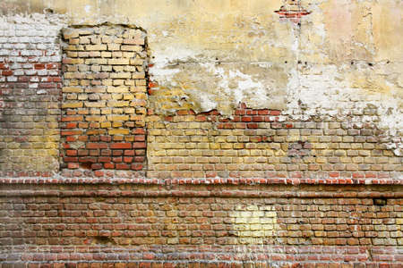 Old brick wall with the closed window photo