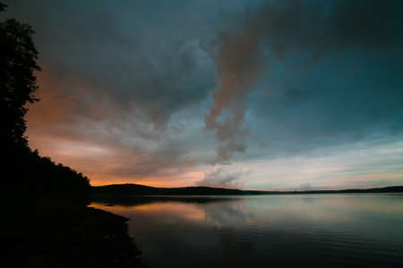 Sunset on the bank of lake in the evening Stock Photo - 15256299
