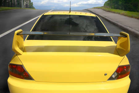 Yellow sports car on city road Stock Photo - 15256323