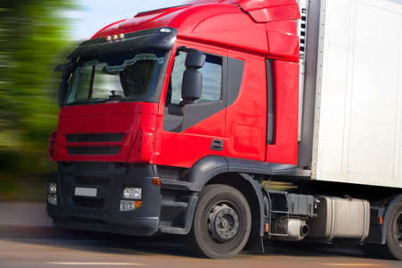 truck on highway: truck with red cabin goes on road Stock Photo