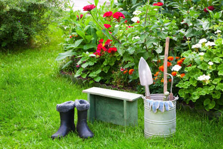 garden bench: Garden stock on lawn near  bed