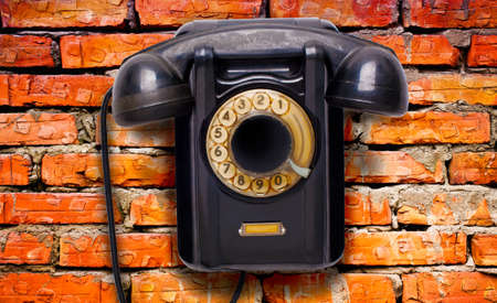 rotational: Old black rotational phone on wall Stock Photo