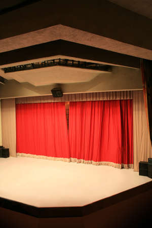 covered theatrical scene with a red curtain photo