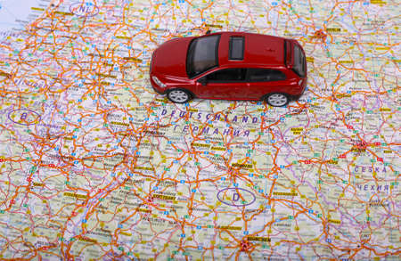 Map of Europe and red car toy photo