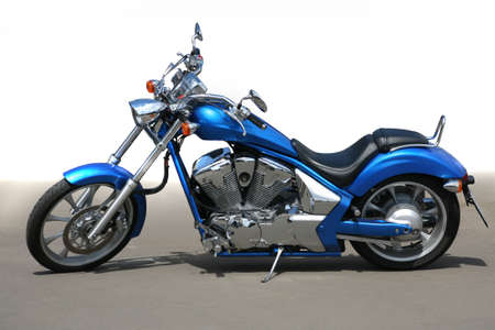 blue beautiful powerful motorcycle on asphalt