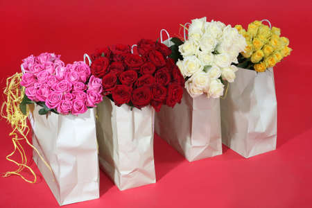 packages with bouquets of roses of different color photo