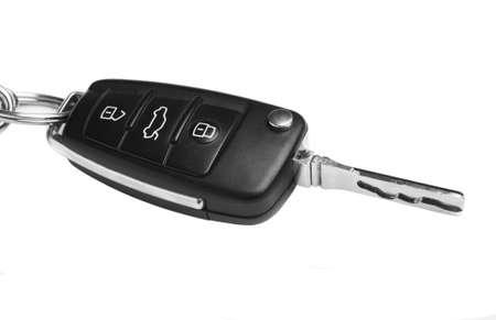 key in chain: car key black plastic on white background