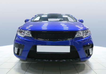 car manufacturing: new blue car in motor show