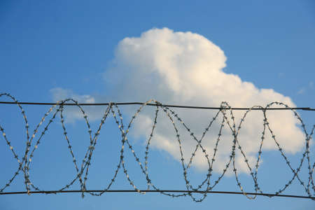 Metal barbed wire against  sky Stock Photo - 17201467