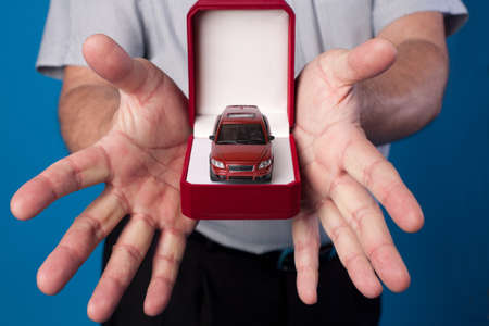 open box with car in mans hands Stock Photo - 17218336