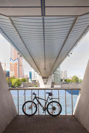 bicycle parked under bridge footings against the business center Stock Photo - 17715337