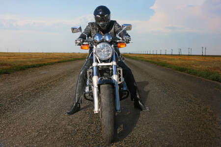 motorcyclist on the motorcycle in helmet on the road photo