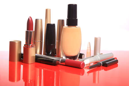 cosmetics set on the red polished table photo