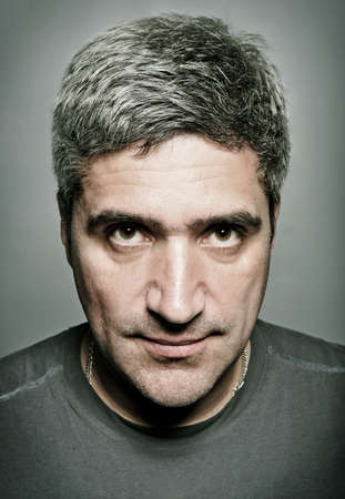 intense: portrait of the adult man with gray hair