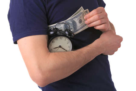 man holds dollars and an alarm clock photo