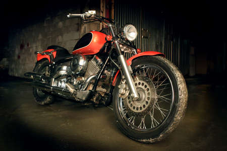 old motorcycle: big red motorcycle in dark garage Stock Photo