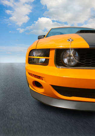 sports track: yellow sports car on the highway close up Stock Photo