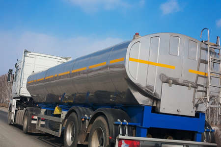 fuel truck with the chromeplated tank goes on the highway photo