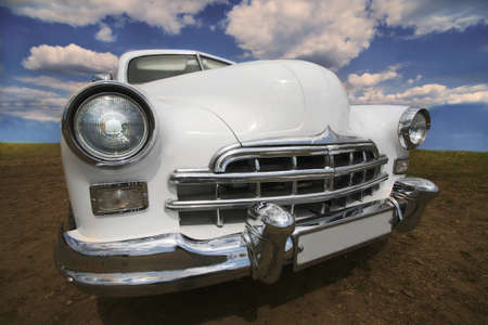ancient white car in the afternoon outdoors photo