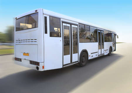 goes: white city bus goes on the road