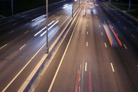 night wide highway with moving cars Stock Photo - 21585967