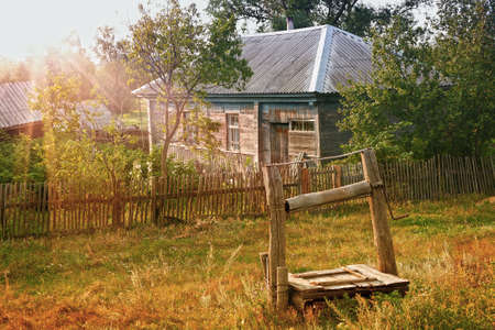 wooden house with garden in the Russian village photo
