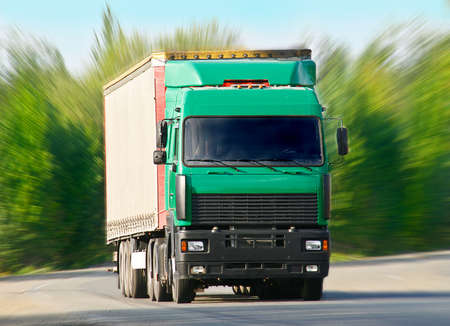 big truck with green cabin goes on the highway Stock Photo - 21585976
