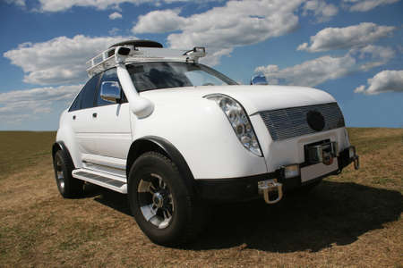 4x4: big white off-road car in the field