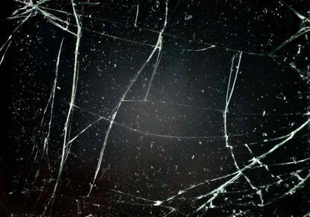 cracked glass: glass with cracks on black background Stock Photo