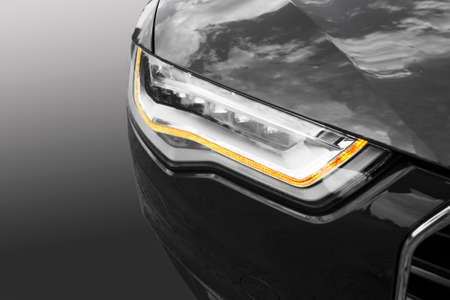background lights: headlight of modern prestigious car